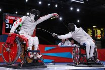 LONDON, ENGLAND - SEPTEMBER 08: Daoliang Hu of China (L) competes against Alim Latrech (R) of France during the Men's Team Catagory Open Wheelchair Fencing Final on day 10 of the London 2012 Paralympic Games at ExCel on September 8, 2012 in London, England. China won the match securing a Gold Medal. (Photo by Dan Kitwood/Getty Images)